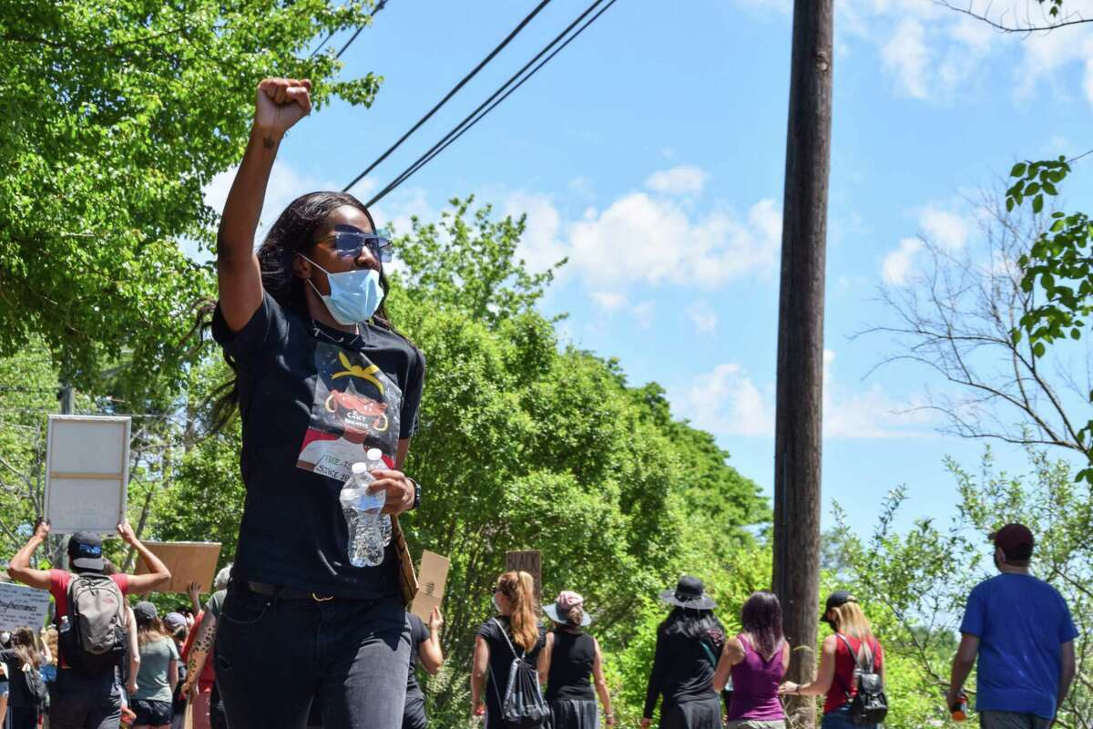 Hundreds of peaceful protesters hit the streets Saturday afternoon in East Hampton during a Black Lives Matter march from Stop & Shop, down Lake Drive alongside Lake Pocotopaug, and back again. Kiana Bronsu, left, organized the event.