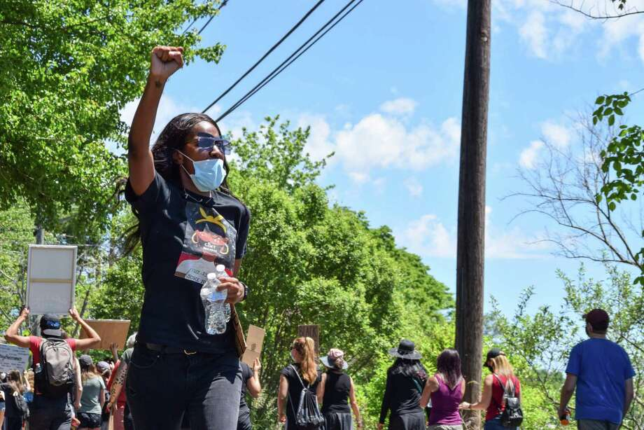 Hundreds of peaceful protesters hit the streets Saturday afternoon in East Hampton during a Black Lives Matter march from Stop & Shop, down Lake Drive alongside Lake Pocotopaug, and back again. Kiana Bronsu, left, organized the event. Photo: Michelle France Photo
