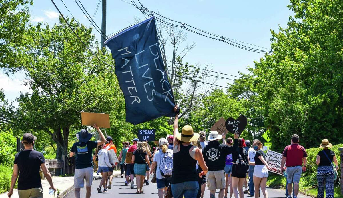 Hundreds of peaceful protesters hit the streets Saturday afternoon in East Hampton during a Black Lives Matter march which stepped off from the Stop & Shop parking.