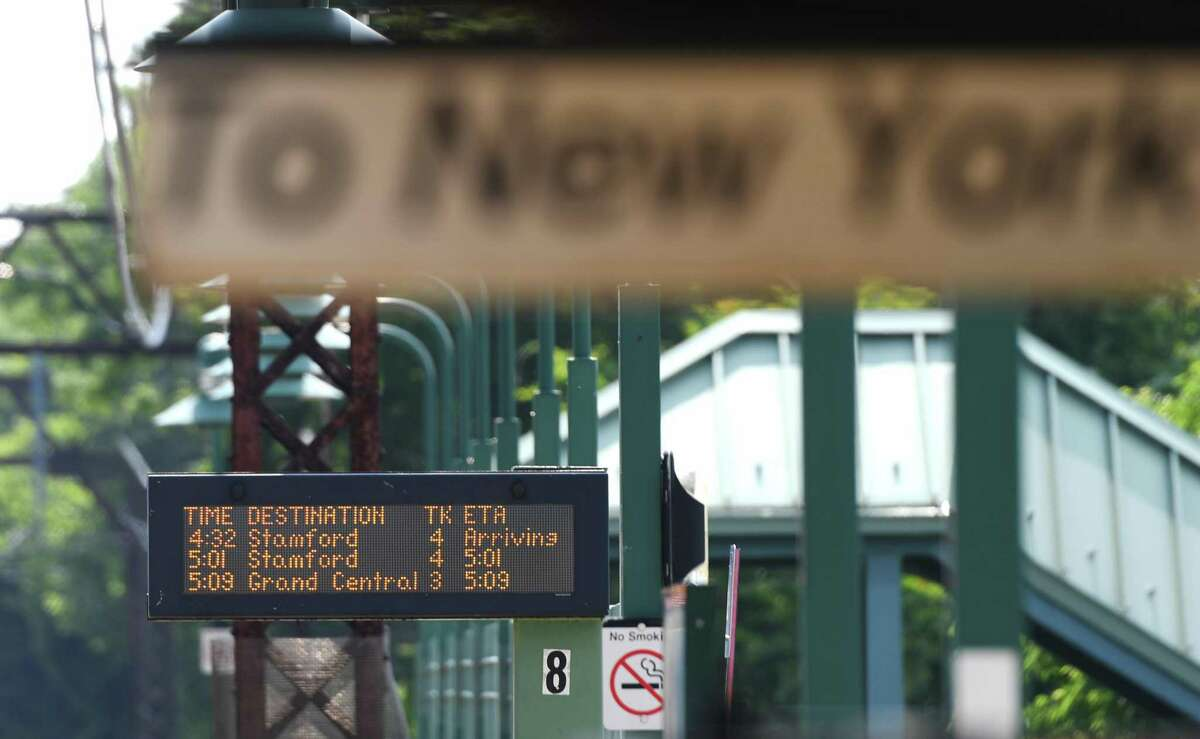 The rush hour train schedule is posted Wednesday at the Greenwich Metro-North station. New York City has entered Phase 1 of its reopening, and Metro-North has greatly expanded train service from Connecticut.