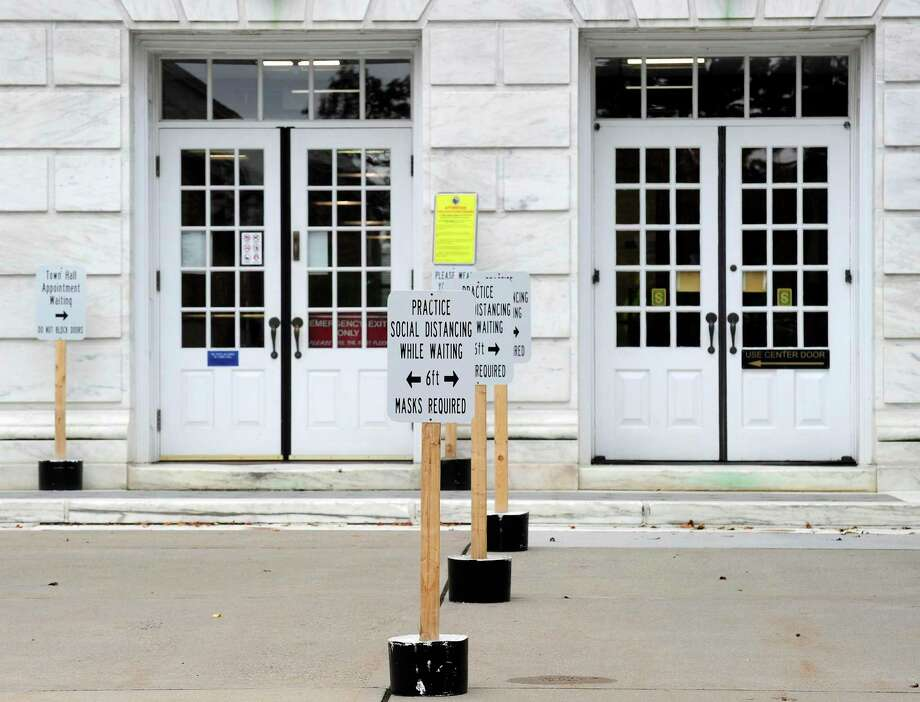 Signs of reminder for visitors, on Social Distancing rules, Stay 6 feet Apart, are posted in front of the Greenwich Town Hall on June 11, 2020 in Greenwich, Connecticut. Photo: Matthew Brown / Hearst Connecticut Media / Stamford Advocate