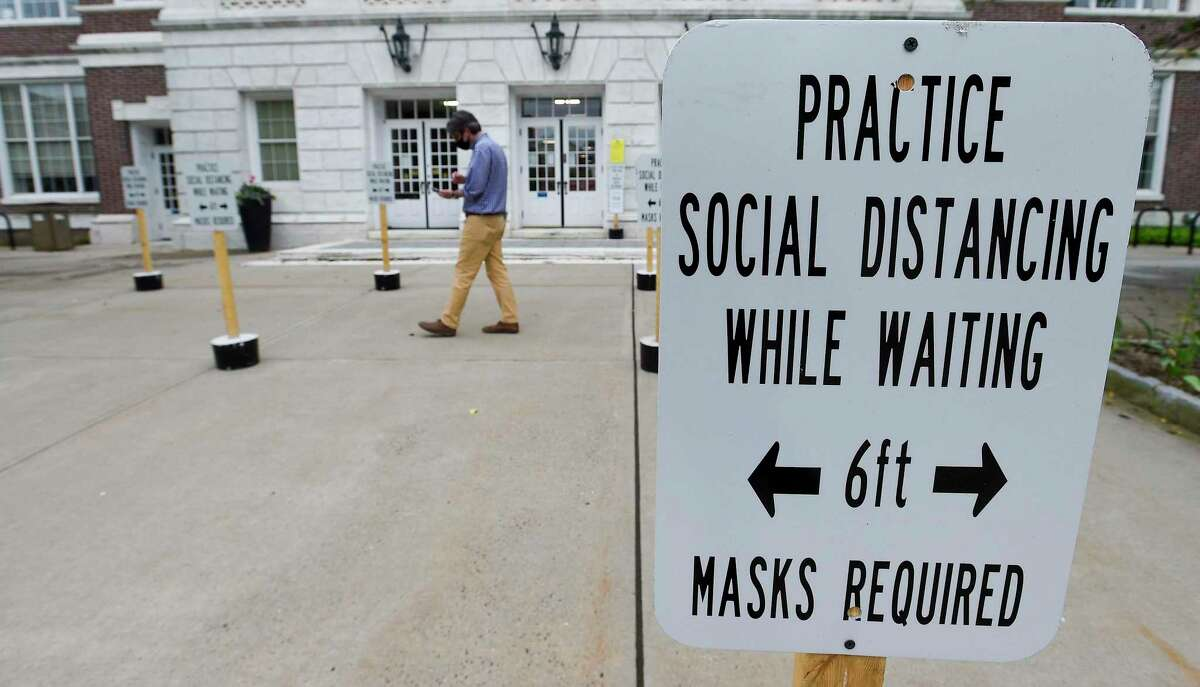 Signs of reminder for visitors, on Social Distancing rules, Stay 6 feet Apart, are posted in front of the Greenwich Town Hall on June 11, 2020 in Greenwich, Connecticut.