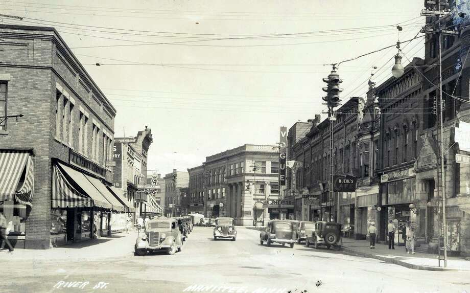 Many of the buildings on Manistee's River Street that were there in the late 1930s still exist to this day.