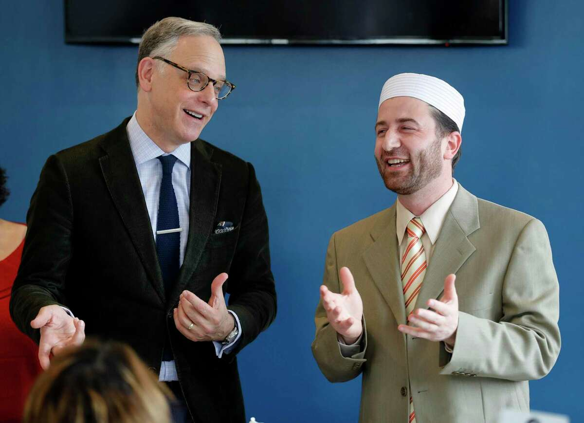 Rabbi Edwin Goldberg, with Congregation Beth Shalom of The Woodlands, left, shares a laugh with Imam Rihabi Mohamed, with the Islamic Center of The Woodlands, during Break Bread and Boundaries at Lama Cafe, Wednesday, Jan. 29, 2020, in Shenandoah. The Islamic Center of The Woodlands hosted the event to raise funds for the Montgomery County Food Bank and start dialogues across religions. Now, the faith leaders are coming together again in the wake of weeks of protests, to discuss their role in addressing racial inequality.
