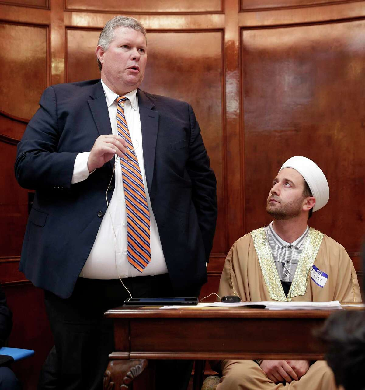 """Craig Sorneson, left, president of the Church of Jesus Christ of Latter-day Saints, speaks as Imam Mohammed Rihabi, left, listens during the """"Standing As One Healing After New Zealand"""" program, a prayer and remarks vigil with community and local faith leaders at The Woodlands Muslim Community at Masjid Al-Ansaar Mosque Friday, March, 22, 2019 in The Woodlands, TX. The communities have come together again in the wake of the death of George Floyd to discuss their roles in addressing racial inequality."""