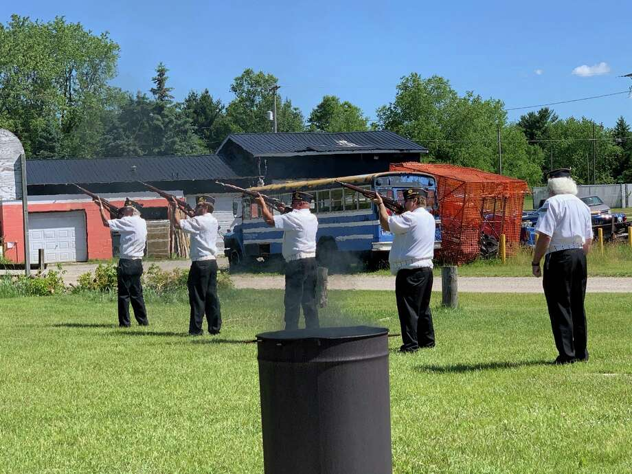 Veterans performed the 21-gun salute in honor of fallen soldiers during a flag burning ceremony at the American Legion Post 98 on Flag Day, June 14. The ceremony was to properly dispose of flags that are no longer serviceable. (Pioneer photo/Cathie Crew)