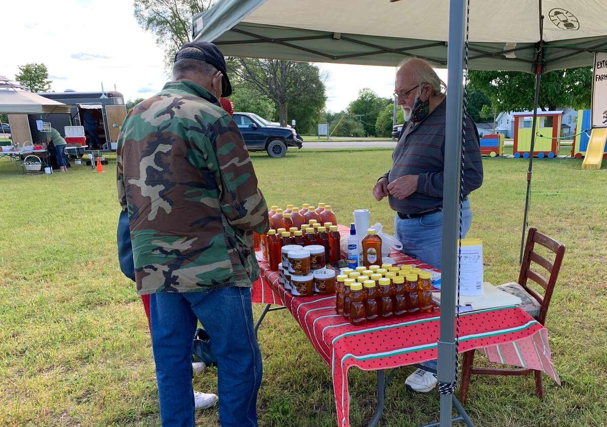 Local area farmers' markets opened this past weekend, June 13, with limited booths, and social distancing restrictions in place. Masks and hand sanitizer were made available for visitors. Evart and Reed City farmers' markets will be open Saturdays through October.