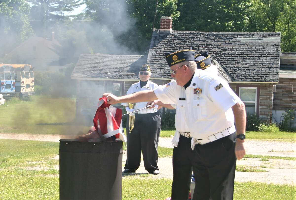 American Legion Post 98 in Big Rapids hosted a Flag Day ceremony June 14, during which they properly disposed of worn and tattered flags that were no longer serviceable. Veterans wee assisted by local scouts in the burning of the flags.