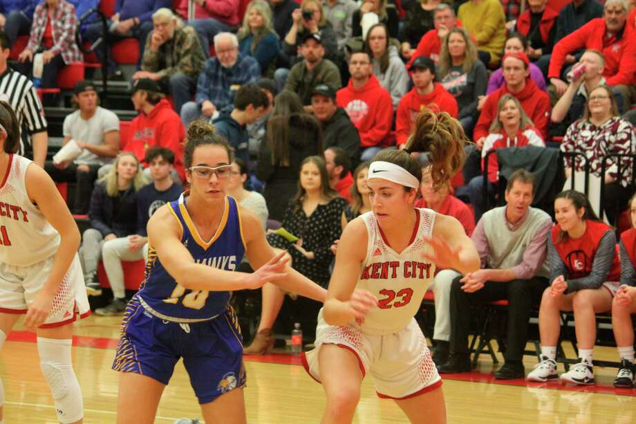 Breanna Berry (left) was a three-sport Morley Stanwood athlete in basketball, volleyball and track. (Pioneer file photo)