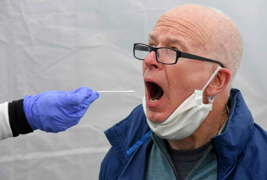 Greenwich resident Larry Heath, 73, is given an Rapid Oral Covid-19 test for the COVID-19 Coronavirus at a testing site set up at the Family Center at Wilbur Peck Court in Greenwich, Connecticut on May 1, 2020. Some 60 Rapid Covid-19 test were performed, yeilding results in less than a day. Photo: Matthew Brown / Hearst Connecticut Media / Stamford Advocate