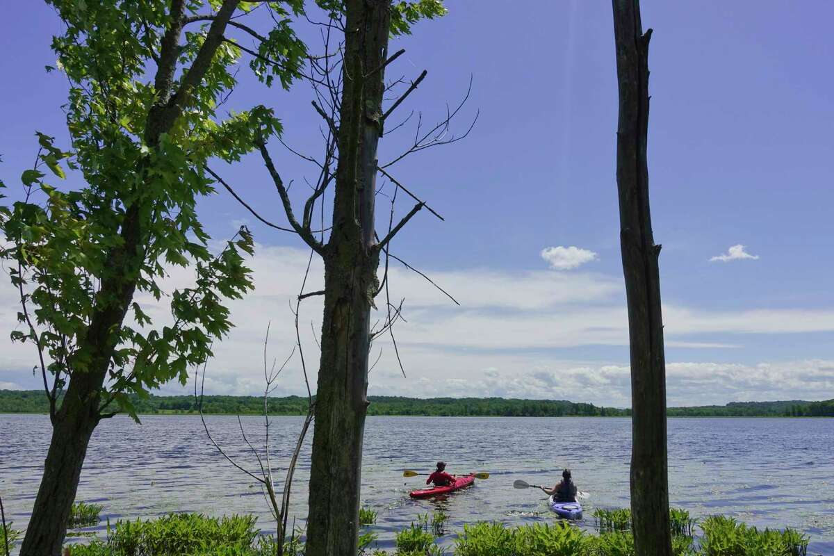 Kayakers head out onto Round on Sunday, June 14, 2020, in Round Lake, N.Y. (Paul Buckowski/Times Union)