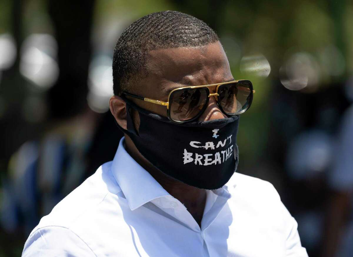 LaDon Johnson wears a facemask with the words