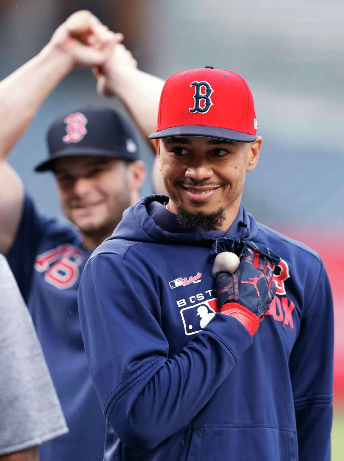 Boston Red Sox's Mookie Betts, right, and Andrew Benintendi wait their turn to take swings in the batting cage after the team's baseball game against the New York Yankees was postponed due to impending rain, Thursday, May 30, 2019, in New York. (AP Photo/Kathy Willens)