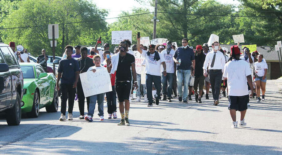 Several hundred marchers head down Paul Street, in Alton, to the Alton Acres community center during a Black Lives Matter rally late Sunday afternoon. The group marched from Northside Park to the community center, where there were a number of speakers, voter registration and other activities. The event was one of a series of protests held throughout Madison County, Jerseyville and the nation in recent weeks. Photo: Scott Cousins|The Telegraph