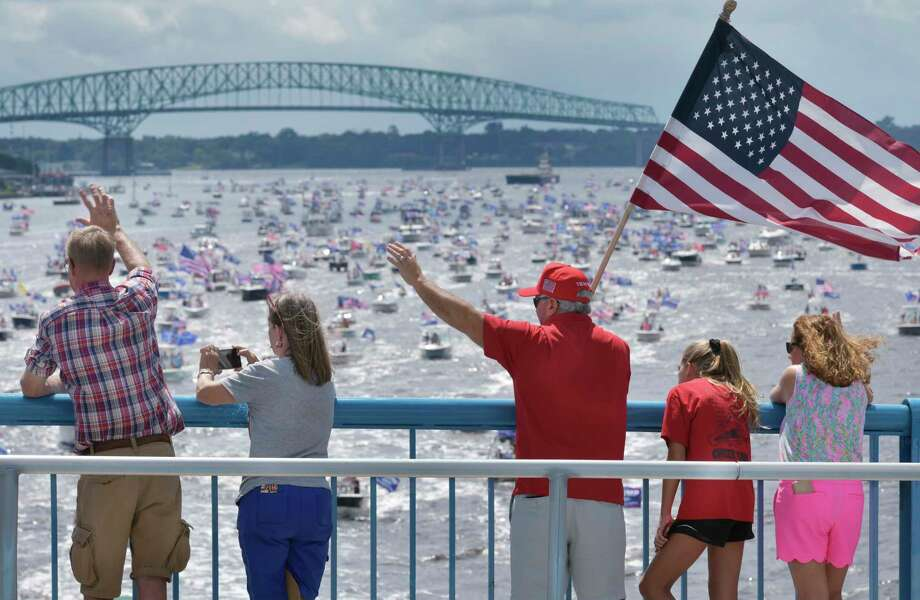 FILE: Supporters of President Donald Trump wave at the hundreds of boats idling on the St. Johns River during a rally Sunday, June 14, 2020, in Jacksonville, Fla., celebrating Trump's birthday. (Will Dickey/The Florida Times-Union via AP) Photo: Will Dickey-- / Will Dickey/Florida Times-Union
