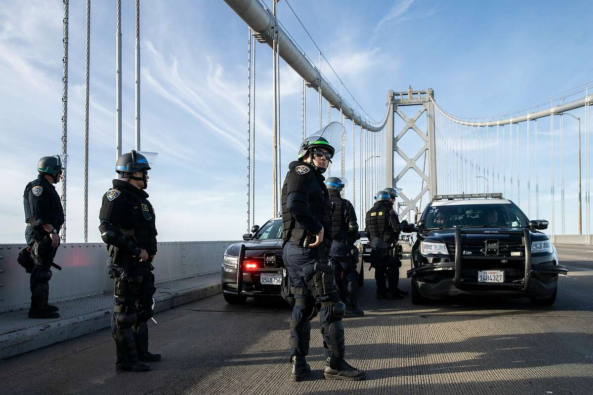 California Highway Patrol on the Bay Bridge, Sunday, June 14, 2020, in San Francisco, Calif. Approximately 50 vehicles rolled to a stop shortly after 4:30 p.m. on the upper deck in between Treasure Island and San Francisco, according to CHP officer Mark Andrews. They got out of their vehicles and spray painted BLM, for Black Lives Matter, on the deck of the bridge. Andrews said other writing is on the walls on the sides of the lanes. At least 27 protesters were arrested, according to San Francisco Sheriff's Office spokeswoman Nancy Crowley.