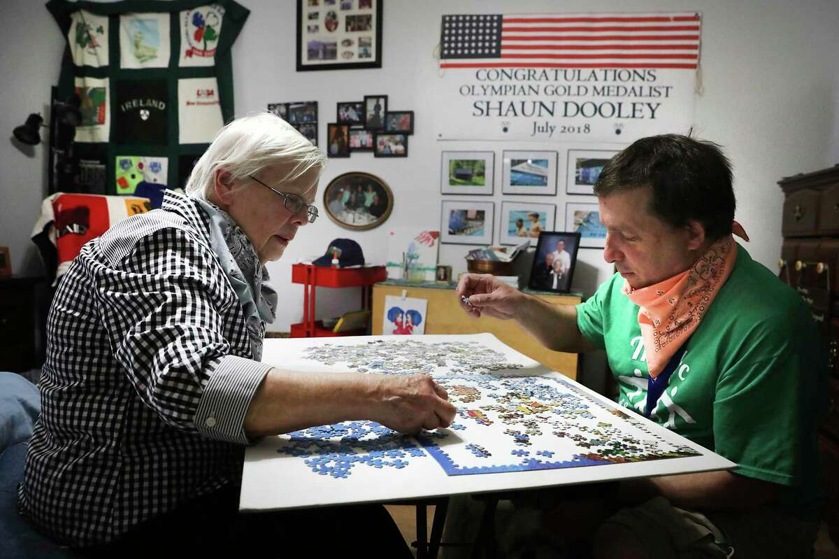 Shaun Dooley, right, enjoys putting together a jigsaw puzzle with his mother, Toni. He's a participant in The Arc's Adult Life Enrichment program, where he has found meaningful relationships, but The Arc's programs and services are on hold due to the novel coronavirus pandemic.