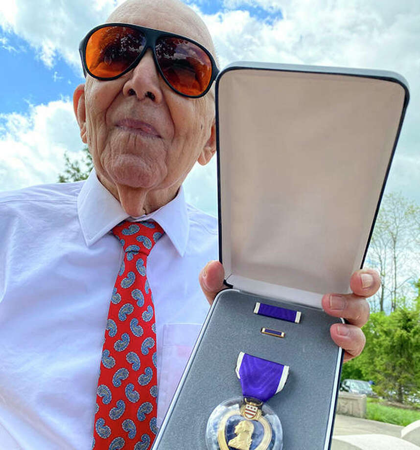 Marcos Montano of Waukegan shows off his replacement Purple Heart medal. Photo: Karie Angell Luc | Pioneer Press (AP)