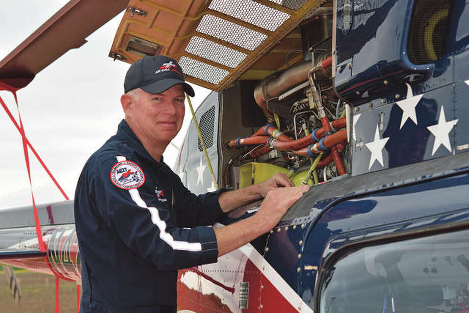 Pilot Craig Rush does an engine check on the Air Evac helicopter prior to his shift at the Passavant Area Hospital base.