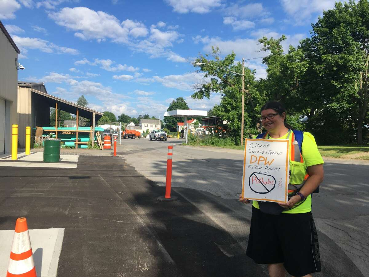 Darlene McGraw protests in front of the Saratoga Springs's DPW garage on Monday, June 15, 2020.
