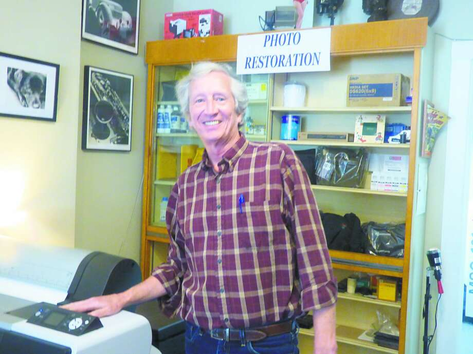 Bill Ferguson, owner of Hokanson Camera in downtown Manistee will retire later this month, ending nearly 40 years in charge of the camera shop and portrait studio. Photo:  Scott Fraley/News Advocate