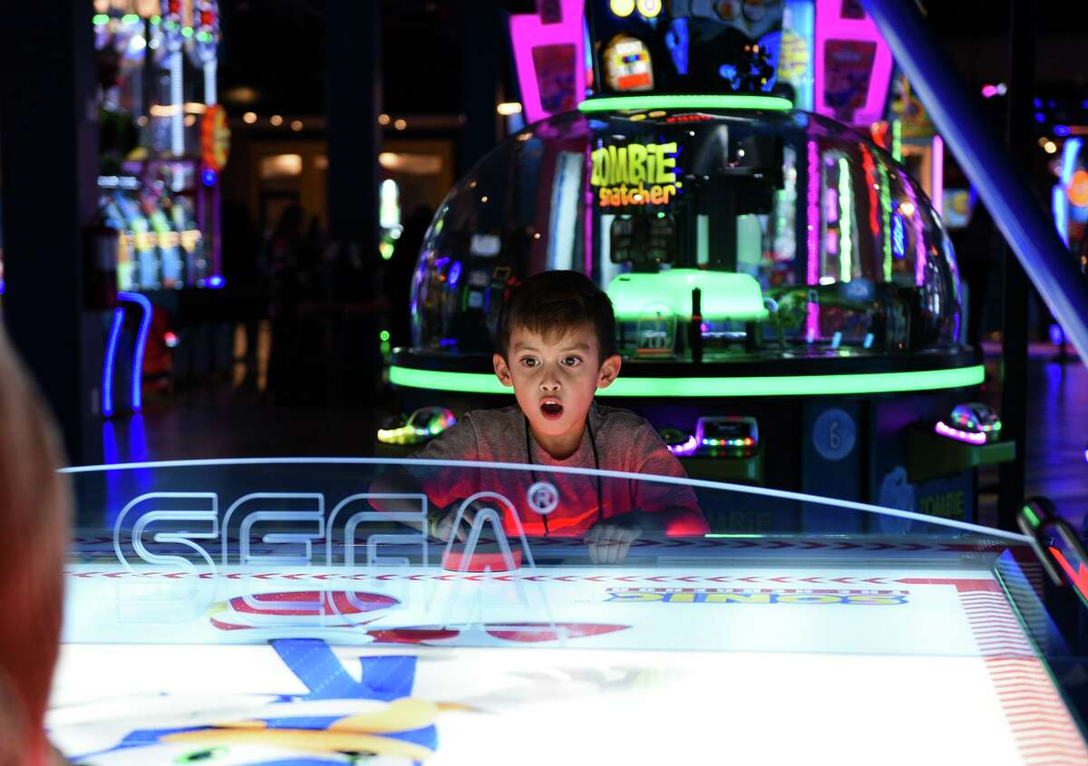 VIP guests try out the arcade games at Main Event on Feb. 15, 2020 during a sneak peek of the entertainment center.