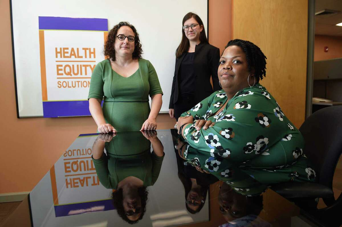 Tekisha Dwan Everette, right, is executive director of Health Equity Solutions in Hartford. She is pictured with staff members Karen Siegel, director of policy, left, and Samantha Lew, policy analyst and advocacy specialist, in their Hartford office. They promote policies and practices that result in equitable health care access for all.