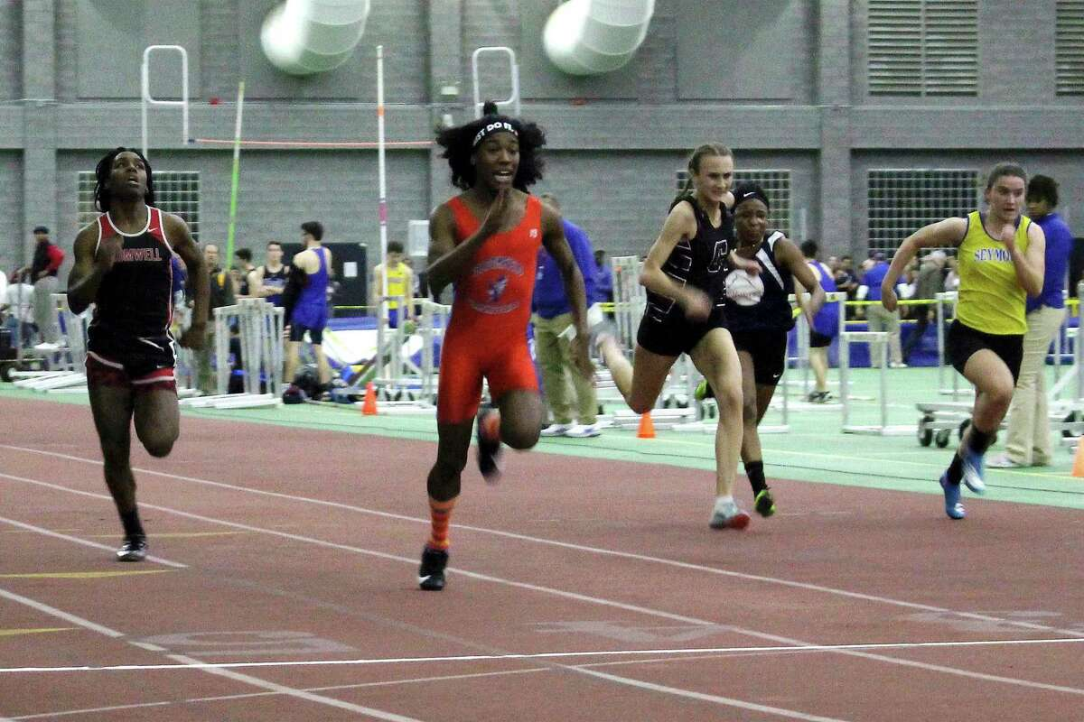 In this Feb. 7, 2019 file photo, Bloomfield's Terry Miller, second from left, wins the final of the 55-meter dash over Cromwell's Andraya Yearwood, far left, and other runners in the Connecticut girls Class S indoor track meet at Hillhouse High School in New Haven, Conn.