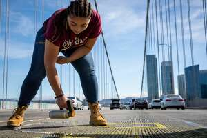 "Westbound traffic on the Bay Bridge in San Francisco, Calif. was brought to a standstill Sunday, June 15, 2020 after all lanes were blocked by protesters. They spray-painted ""BLM,"" the initials to Black Lives Matter, onto the bridge in yellow before being stopped by authorities."