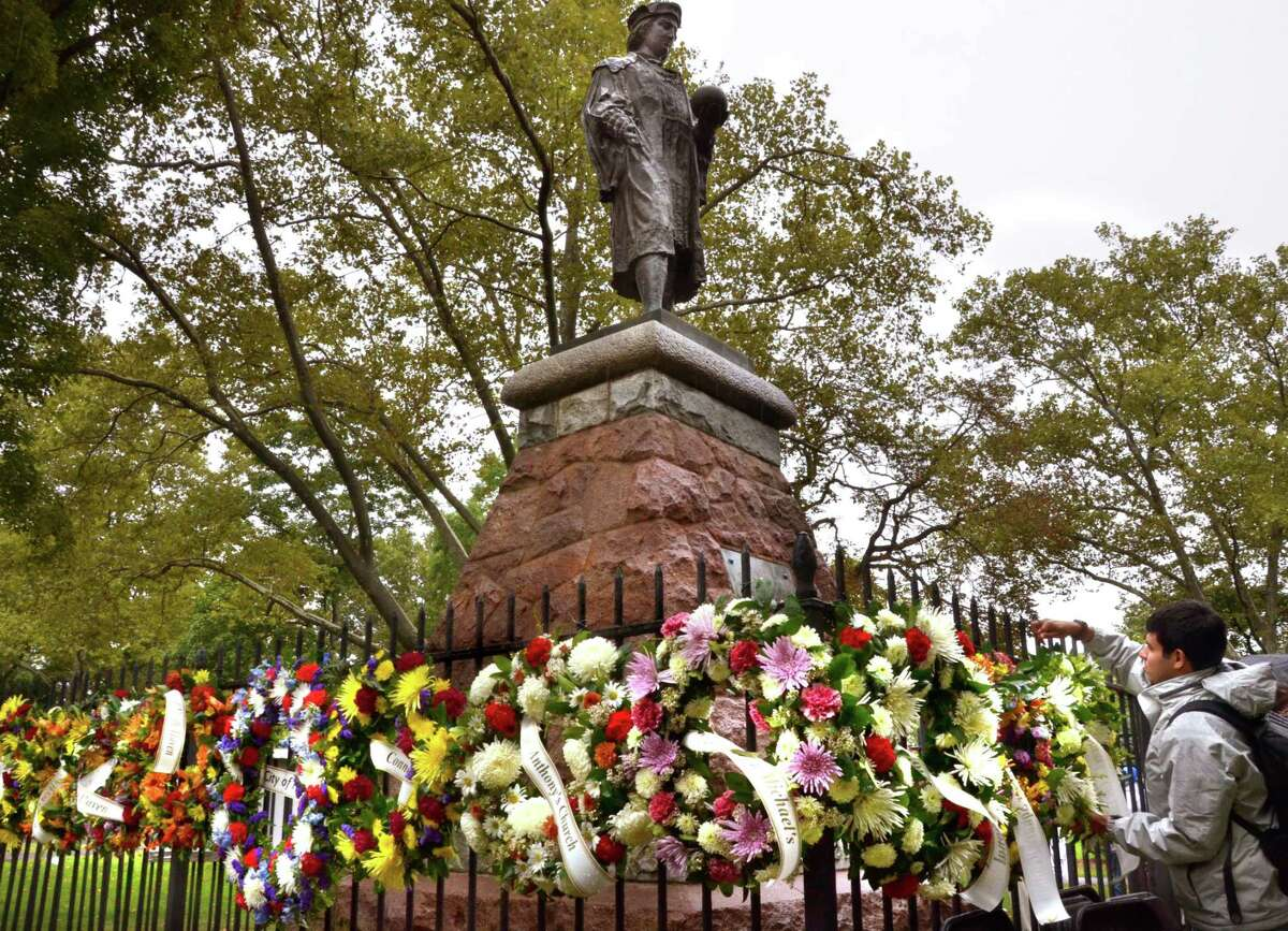 The fencing around the Christopher Columbus statute in New Haven's Wooster Square is traditionally festooned with wreaths during Columbus Day festivities.