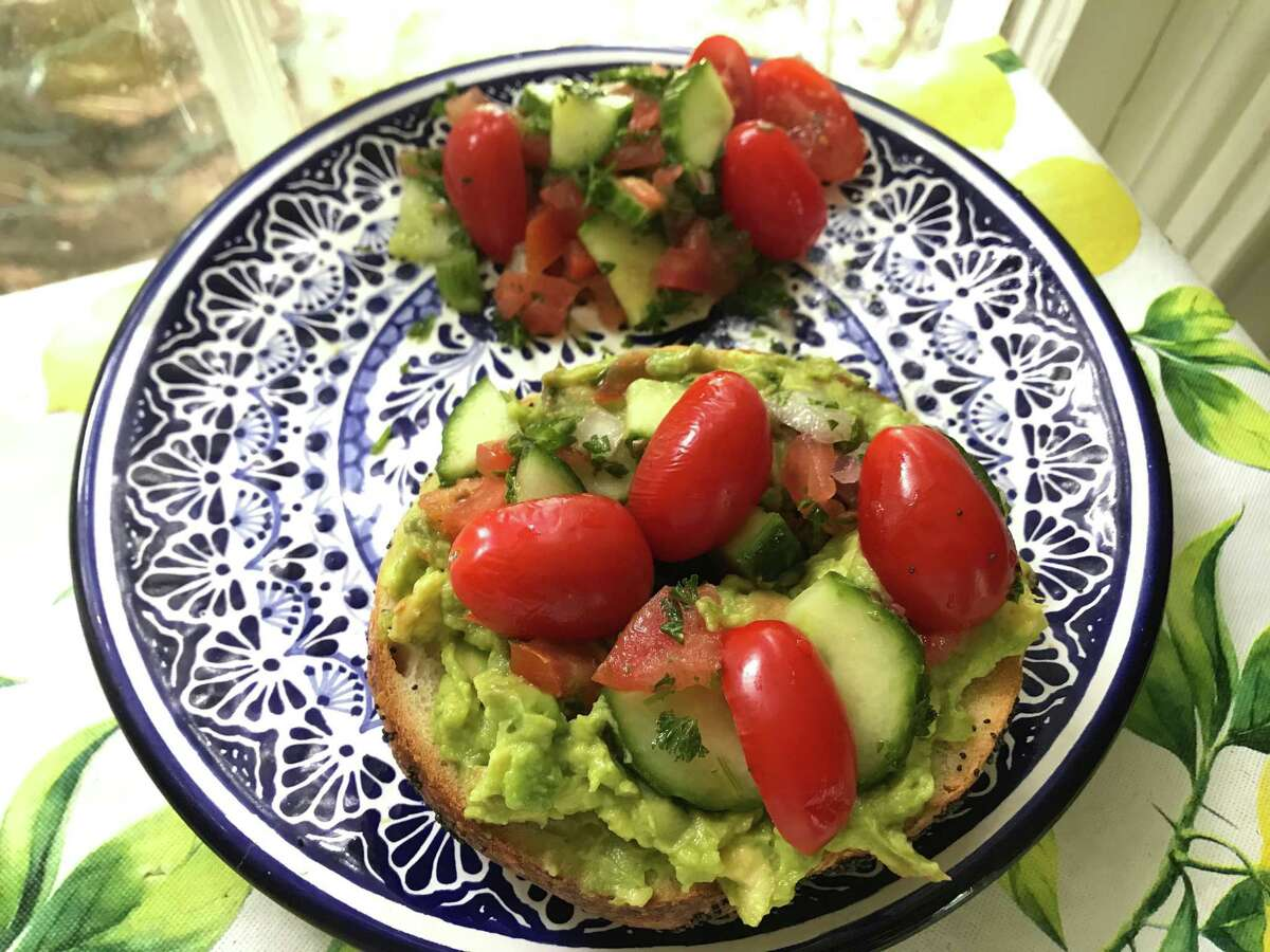 Poppyseed bagel from Golden Bagels with avocado spread, Israeli salad and added grape tomatoes