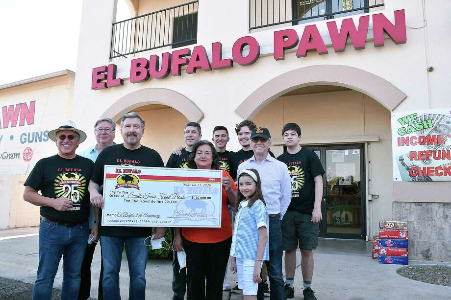 Before hosting a grocery giveaway as part of their 25th anniversary celebration, the owners of El Bufalo Pawn presented a donation for $10,000 to the South Texas Food Bank, Saturday, June 13, 2020. Photo: Cuate Santos /Laredo Morning Times / Laredo Morning Times