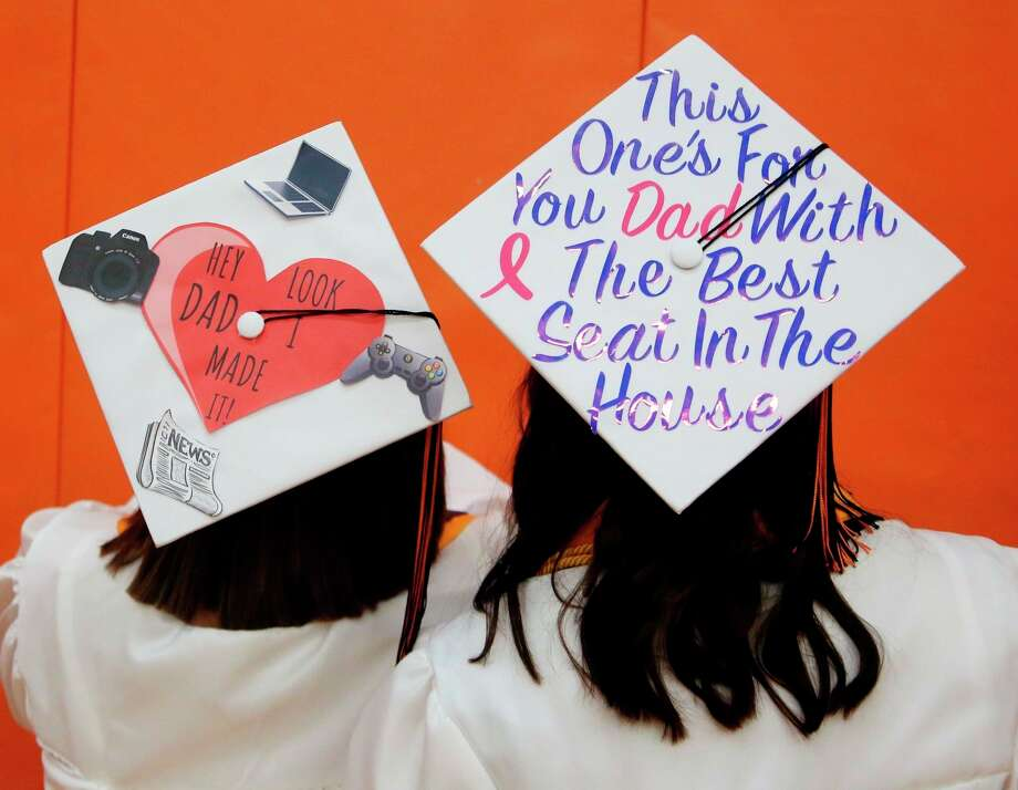 Ubly seniors show off their graduation caps during their 2019 commencement ceremony. This year's ceremony has been up in the air due to the coronavirus pandemic, but school officials said they will have a ceremony some way, some how. (Tribune File Photo)