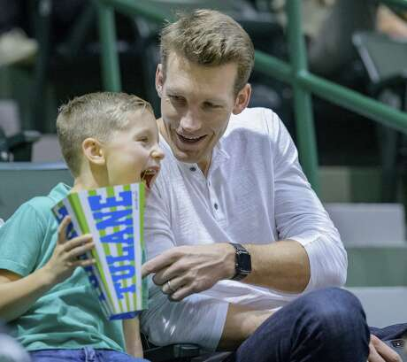 Former NBA player and current scout for the Golden State Warriors Mike Dunleavy Jr. watches the first half of an NCAA college basketball game between Tulane and Houston in New Orleans, Sunday, Feb. 17, 2019. The head coach of Tulane is his father Mike Dunleavy Sr. (AP Photo/Matthew Hinton)