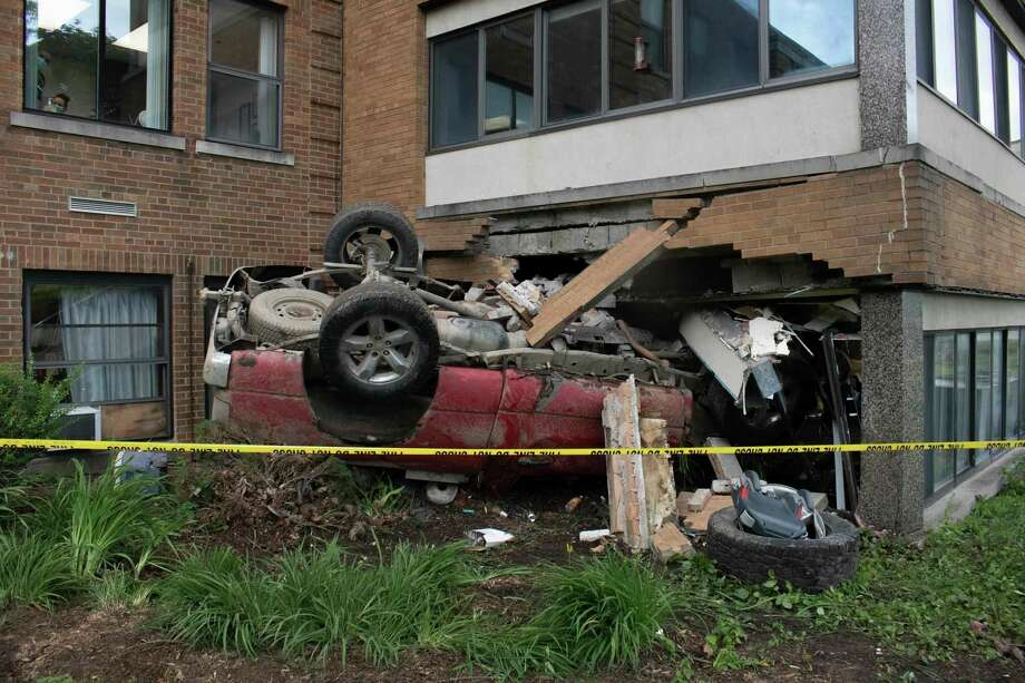 A truck rests upside down inside the Huron County Medical Care Facility Friday after a man crashed into the building and fled the scene. (Aurora Abraham/Huron Daily Tribune)