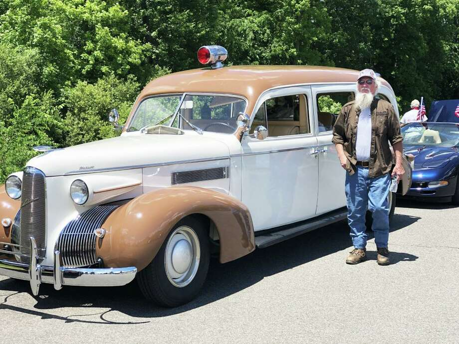 Middletown's Flag Day part-virtual car cruise took place Sunday afternoon with hundreds of participants watching it online and along the streets of a 3.8-mile loop. Steve Marcolini of Lyme waits for the parade to begin next to his 1939 LaSalle ambulance that he restored. Photo: Eileen McNamara Photo