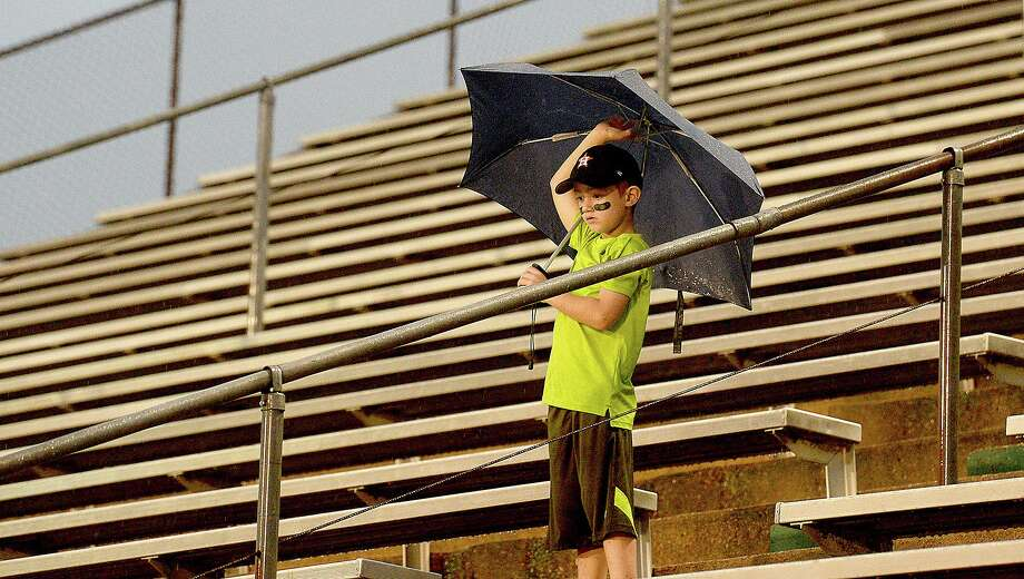 Little Cypress-Mauriceville's fans wait out an extended lightning delay and shelter from persistent rain as they gather to cheer on the team against Vidor during their match-up Friday night at LC-M.  Friday, September 21, 2018  Kim Brent/The Enterprise Photo: Kim Brent / The Enterprise / BEN