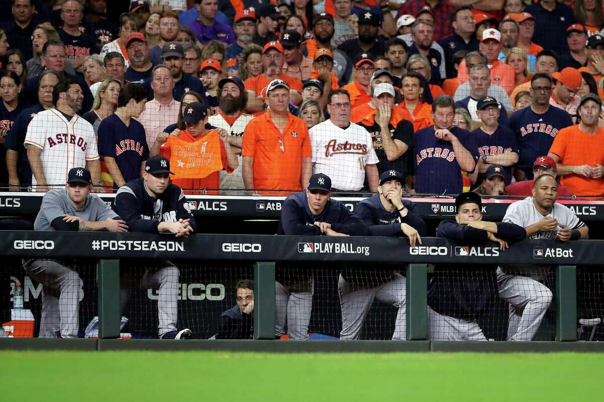 The New York Yankees look on from the dugout against the Houston Astros during the ninth inning in Game 6 of the American League Championship Series at Minute Maid Park in Houston on October 19, 2019.