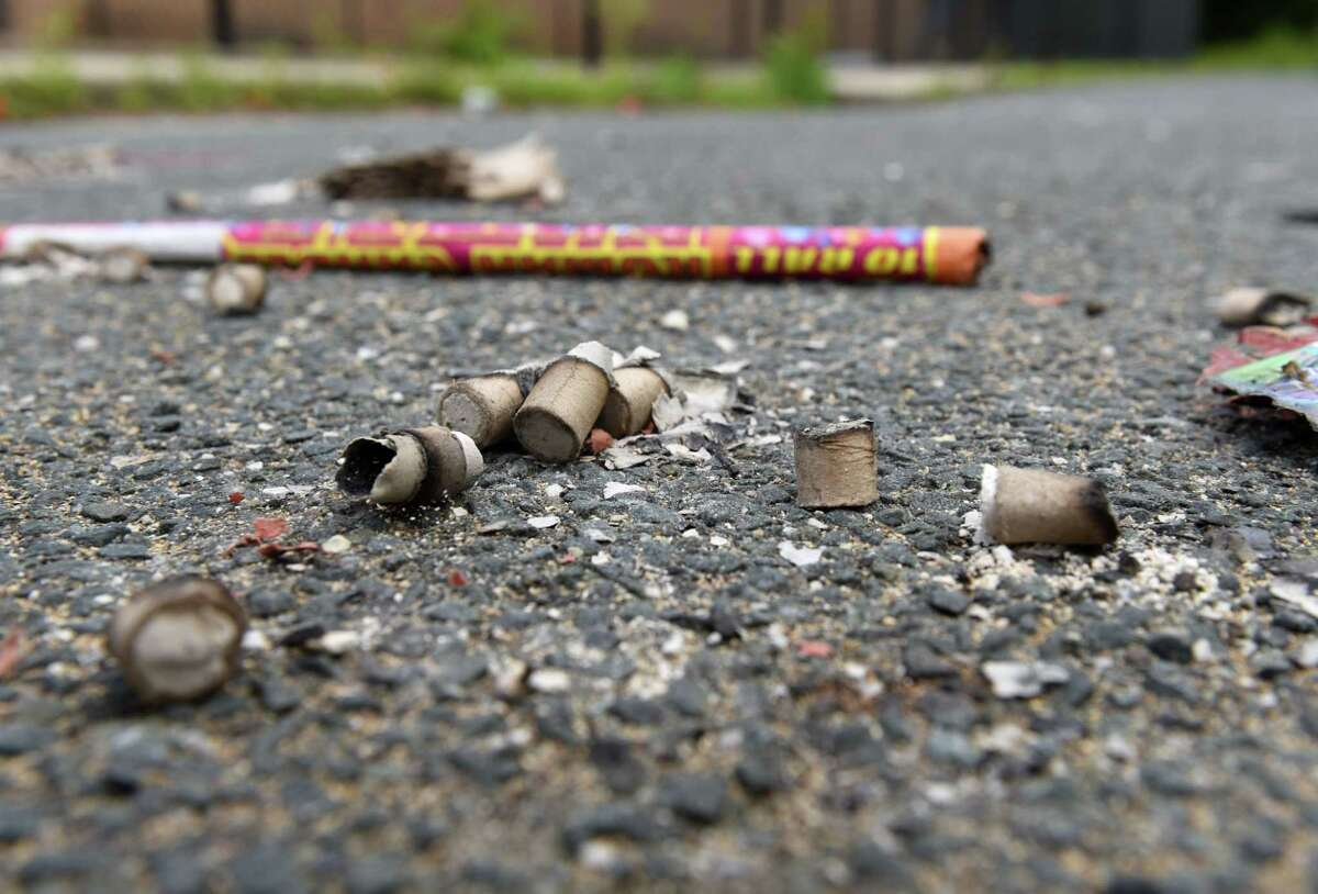 Remains from a impromptu fireworks display litter the ground at South Troy Pool on Monday, June 15, 2020, in Troy, N.Y. In June 2021, a Hoosick Falls man hit himself in the face with a firework. Police caution people not to handle fireworks. (Will Waldron/Times Union)