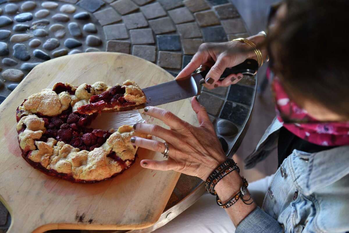 Caroline Barrettportions out a slice of strawberry galette.