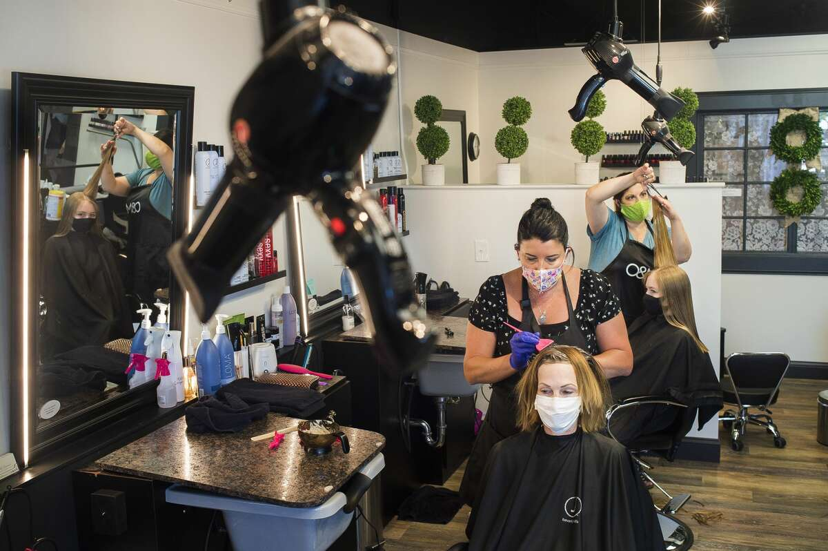 Divine Beauty Studio stylists Harmony Johnson, left, and Kim Binkley, right, work with clients Susan Ward, left, and Brooke Swincicki, right, Monday, June 15, 2020 at the salon at 1124 Eastman Ave., one of many salons and barber shops in Midland which opened Monday as restrictions lifted across the state. (Katy Kildee/kkildee@mdn.net)