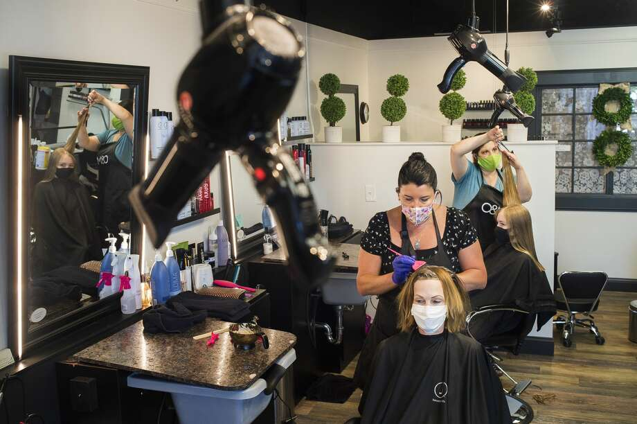 Divine Beauty Studio stylists Harmony Johnson, left, and Kim Binkley, right, work with clients Susan Ward, left, and Brooke Swincicki, right, Monday, June 15, 2020 at the salon at 1124 Eastman Ave. (Katy Kildee/kkildee@mdn.net) Photo: (Katy Kildee/kkildee@mdn.net)