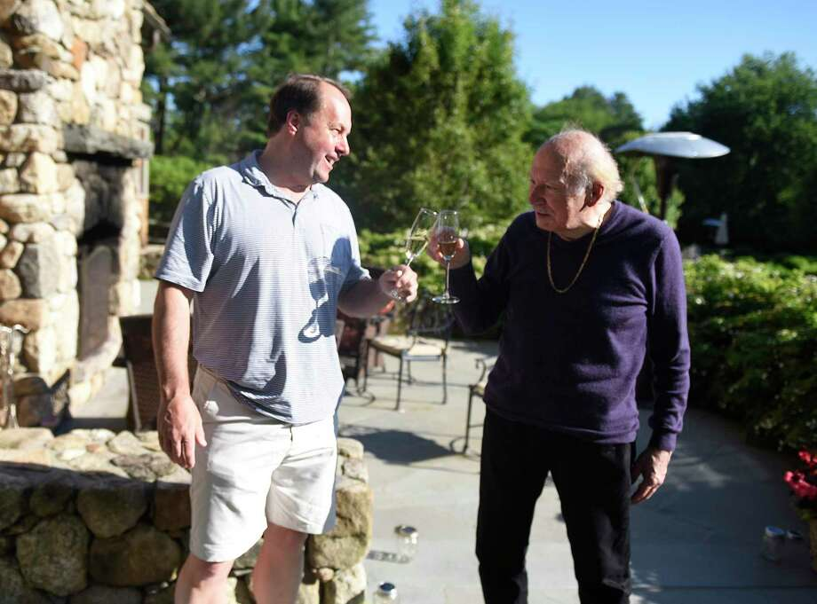 Coronavirus survivor Henry Woerz, 76, rights, drinks a glass of Champagne with Rowayton's Matt Fry, who donated plasma to save his life, at Woerz' son's home in New Canaan, Conn. Sunday, June 14, 2020. Woerz was in grave condition after three weeks on a ventilator battling COVID-19, and was the first patient to receive plasma as part of a clinical trial at Stamford Hospital. Photo: Tyler Sizemore / Hearst Connecticut Media / Greenwich Time