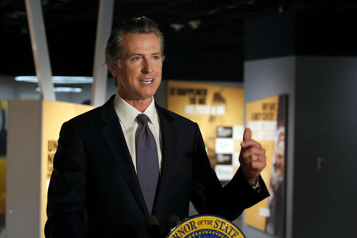 """Gov. Gavin Newsom announced that he has ordered the state police training program to stop teaching a neck hold that blocks the flow of blood to the brain, during a news conference in Sacramento, Calif., Friday, June 5, 2020. Speaking from the Unity Center at the California Museum, Newsom said he ordered the state Commission on Peace Officer Standards and Training to stop teaching officers how to use the """"carotid holds,"""" following nearly two weeks of protests across the country after the death of George Floyd. (AP Photo/Rich Pedroncelli, Pool)"""