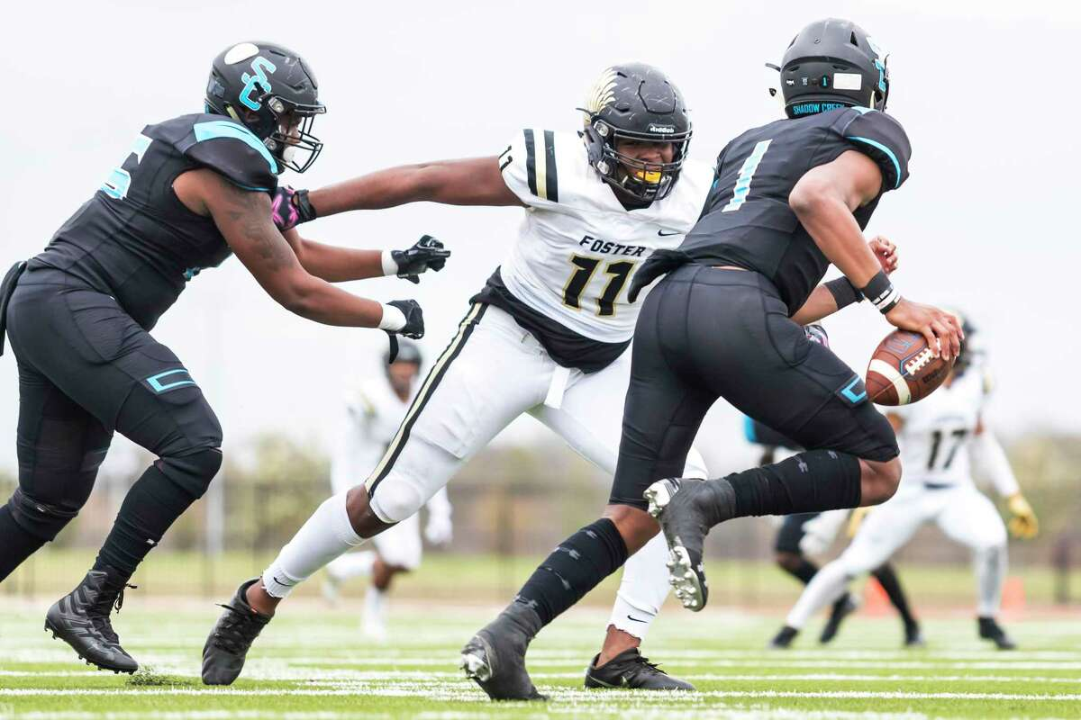 Foster defensive lineman Tyler Onyedim (11) chases Shadow Creek quarterback Kyron Drones (1) out of the pocket in the first half of a class 5A division 1 high school playoff football game Friday, Nov 29, 2019, in League City, Texas.