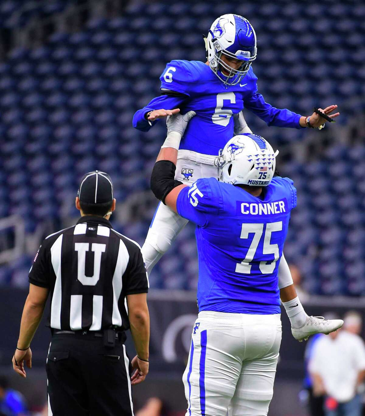 Katy Taylor kicker Renan Baeta (6) celebrates his field goal with offensive lineman Hayden Conner during the first half of a 6A division II regional final high school football game against Cy Creek, Dec. 7, 2019, in Houston.