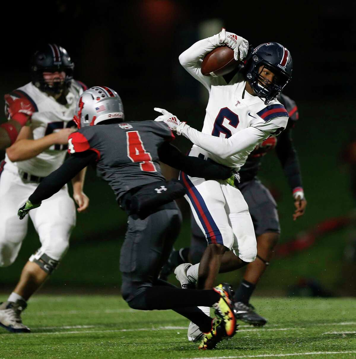 Tompkins Falcons Marquis Shoulders (6) breaks a tackle by Travis Tigers cornerback Jahvon O'neal (4) and rushes for a touchdown during the first half of the high school football playoff game between the Tompkins Falcons and the Travis Tigers at Mercer Stadium in Sugar Land, TX on Thursday, November 14, 2019. The Falcons lead the Tigers 21-14 at halftime.