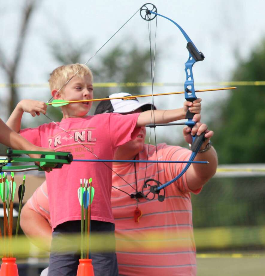 A child practices shooting a bow and arrow during last year's Autumn Fest. This year's event has been canceled due to the coronavirus. (Tribune File Photo)