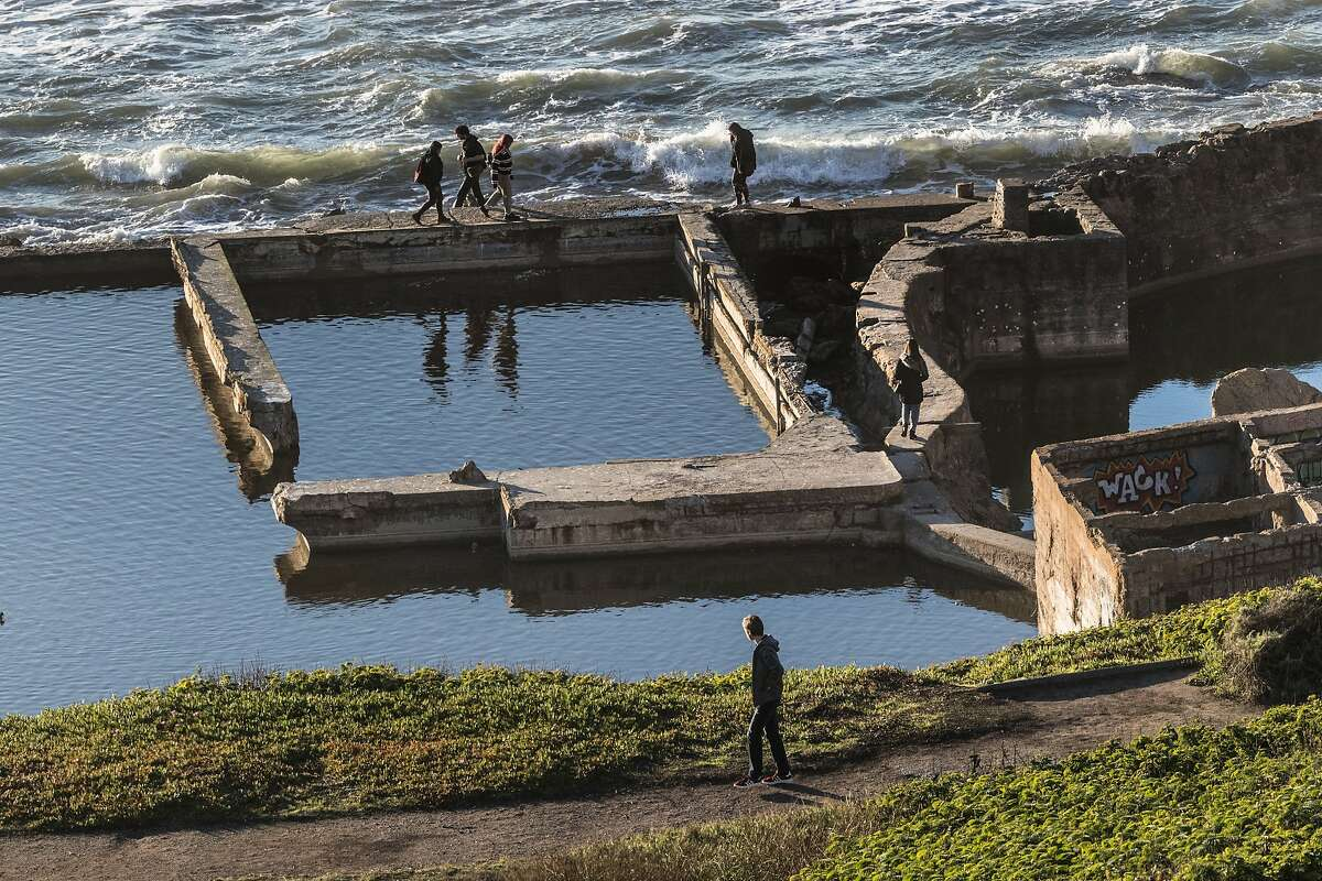 Visitors walk on the Sutro Baths at Lands End Lookout in 2018.