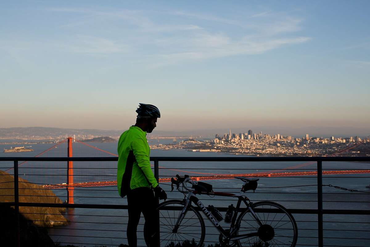 Adil Ansari takes a break after climbing Conzelman Road to Hawk Hill in the Marin Headlands in Marin, Calif., Monday, February 24, 2014